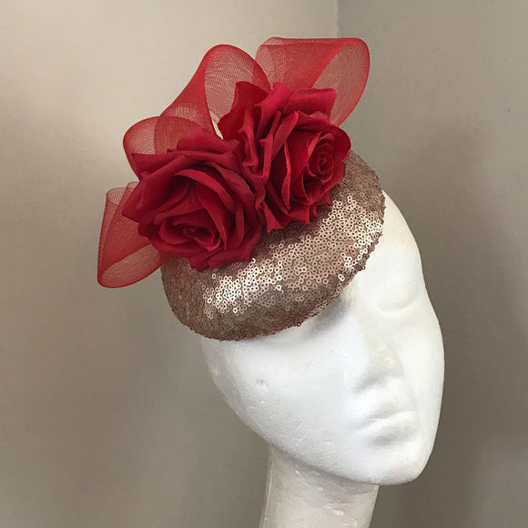 Red and pale rose gold fascinator