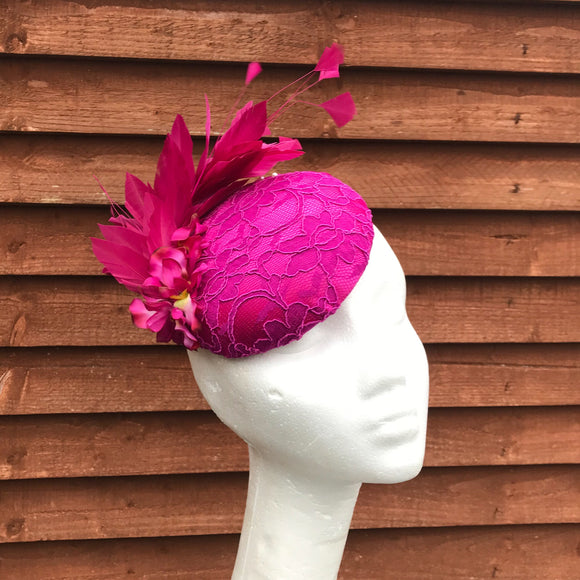 Magenta pink and feather fascinator