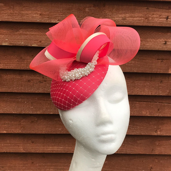 Genevieve coral and cream fascinator