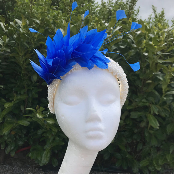 Blue feather and pearl hairband fascinator
