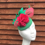 Green and pink fascinator