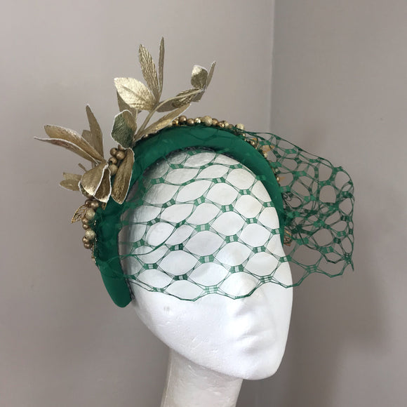 Green and gold hairband fascinator