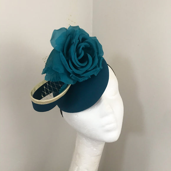 Teal and gold fascinator
