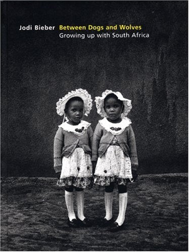 Between Dogs And Wolves: Growing Up With South Africa by Jodi Bieber