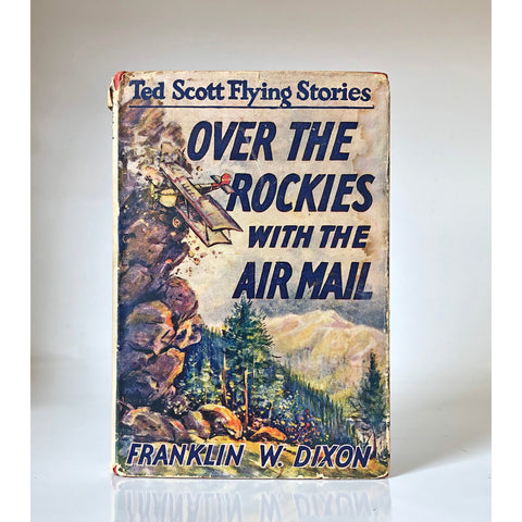 Over the Rockies with the air mail; or, Ted Scott lost in the wilderness by Franklin W Dixon ; illustrated by Walter S. Rogers