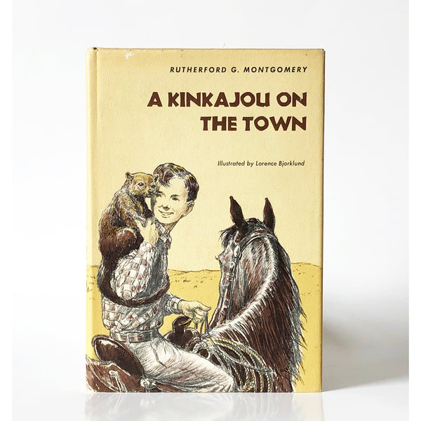 A Kinkajou on the Town by Rutherford G. Montgomery ; illustrated by Lorence Bjorklund