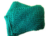 emerald green knit scarf flat lay