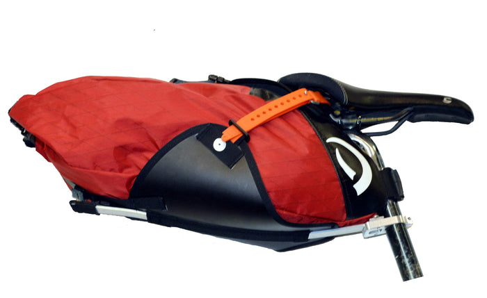 Red Defiant Pack Malamute seat bag and harness attached to bike seat post