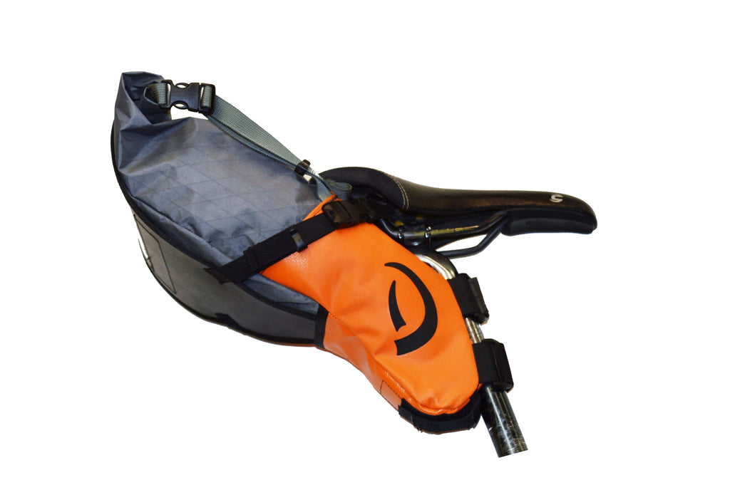 Right-side view of grey/orange Defiant Pack Pearl Pass seat bag XS