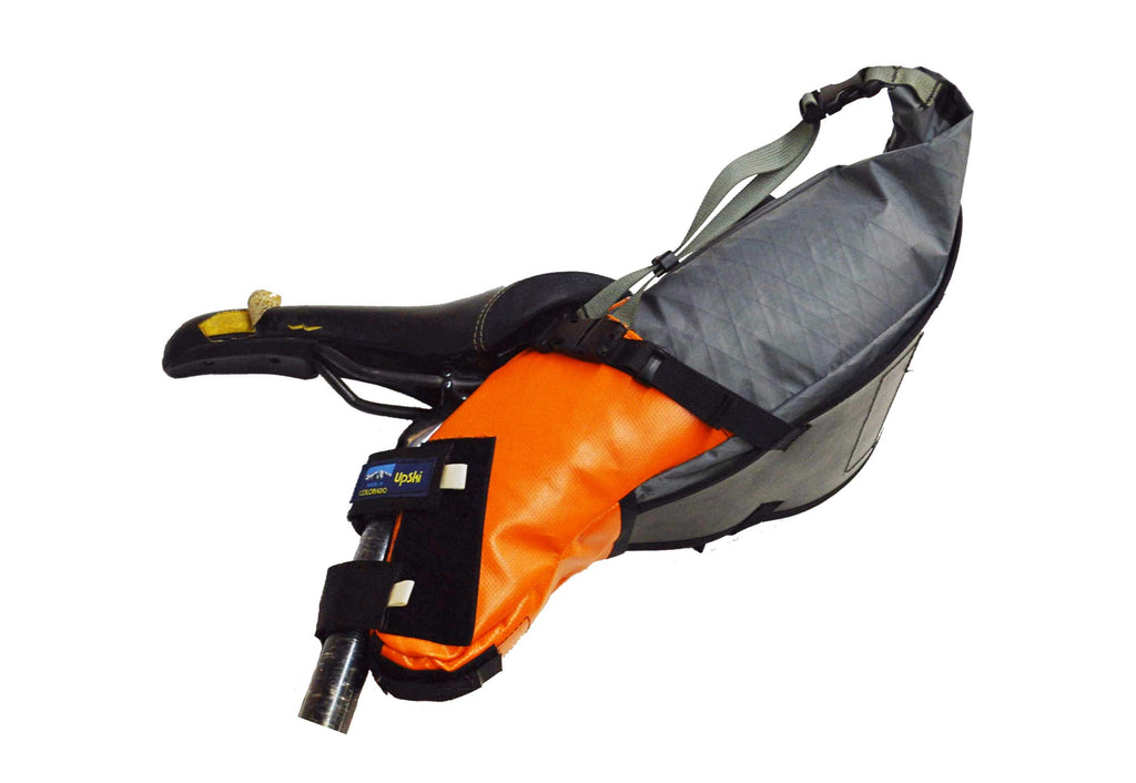 Left-side view of Defiant Pack grey/orange Pearl Pass seat bag XS