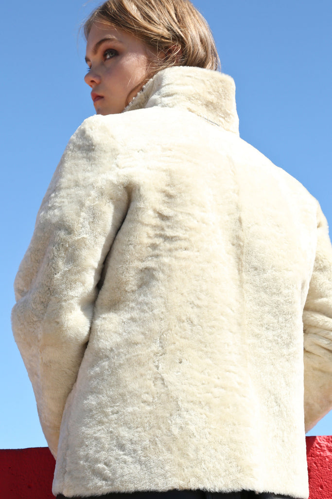 GLOSSY BLACK AND WHITE SHEARLING REVERSIBLE COAT