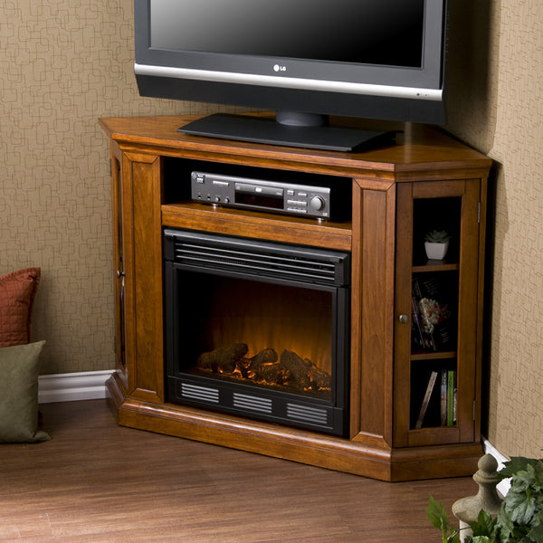 The Holly & Martin™ Ponoma Convertible Media Electric Fireplace-Mahogany has a triangular media storage shelves on either side of the firebox provide plenty of space for your favorite media selections and are enclosed by glass doors. It has additional