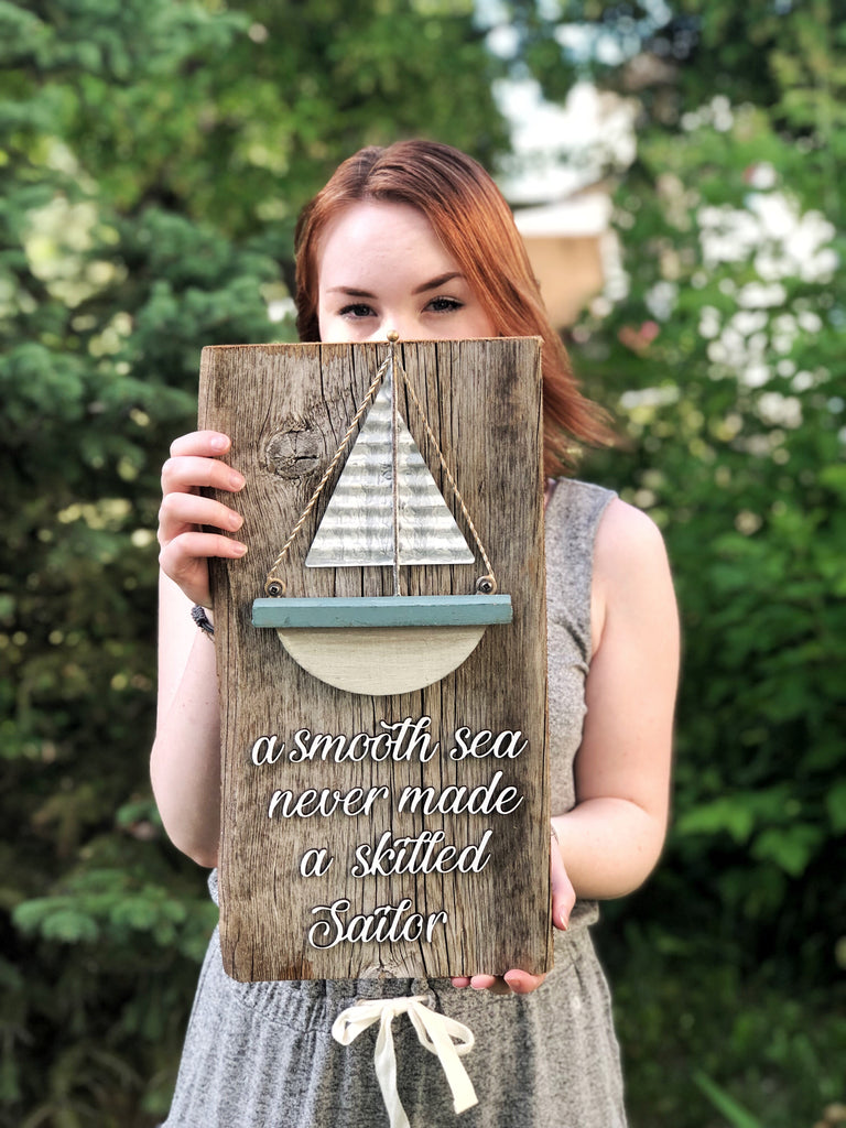 "A smooth sea never made a skilled sailor with metal Sailboat Authentic Barn Wood Sign 7-8"" x 18"" with 3D cut letters"
