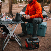 Jackery Explorer 500 power station ischarging coffee kettle while camping.