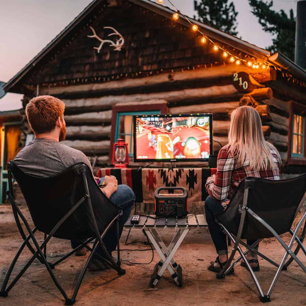 Jackery Explorer 300 Portable Power Station is running a TV that plays switch.