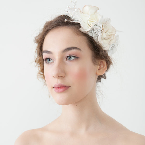 White floral hair band with pearls katthedog white flower asymmetrical hair band on a model side view mightylinksfo