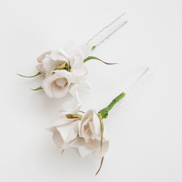 Off-white floral hairpin close-up