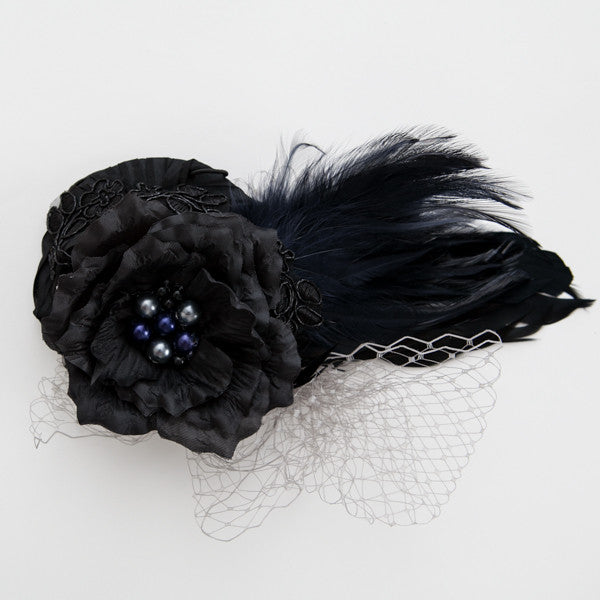 Black cocktail hat with petals