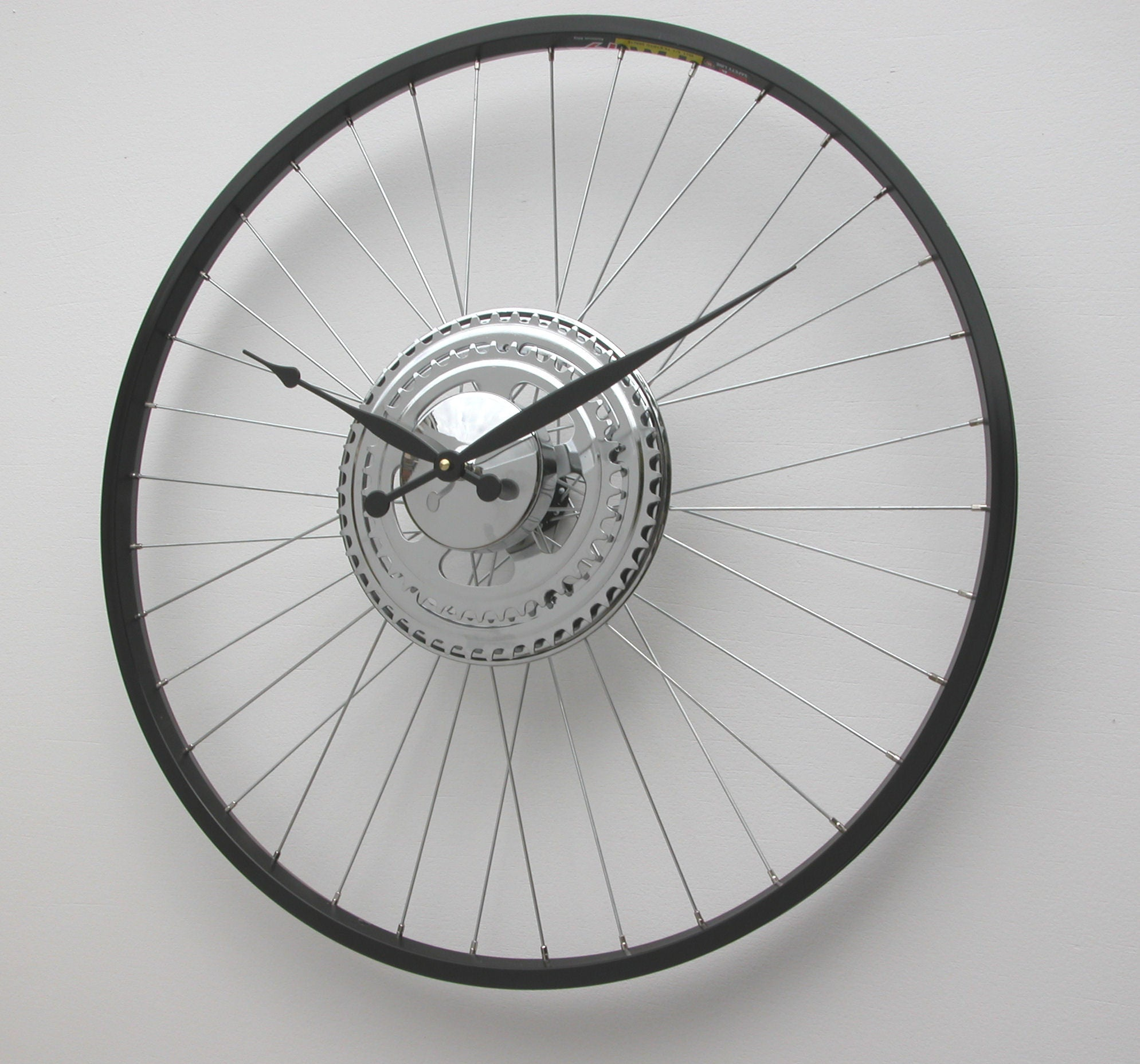 Bike Wheel Clock with black rim and sprocket decoration