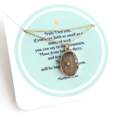 gold-framed mustard seed charm - round
