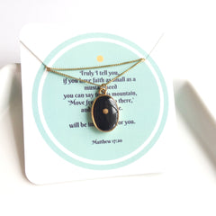 gold-framed mustard seed pendant - oval/black