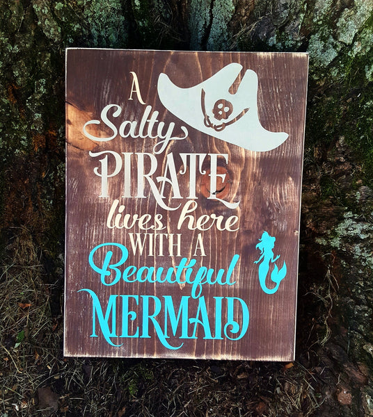 A Salty Pirate Lives Here With A Beautiful Mermaid wood sign