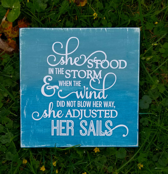 She Stood In The Storm & When The Wind Did Not Blow Her Way, She Adjusted Her Sails wood sign