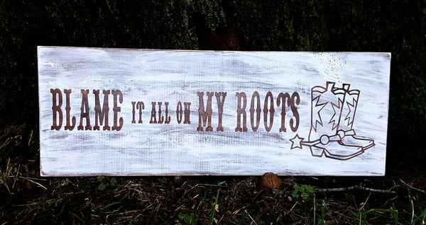 Blame It All On My Roots sign