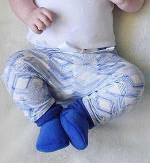 Baby boy wearing Royal Blue Loafie Brights baby slippers