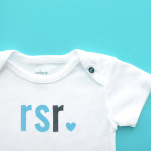 Monogrammed baby onesie with turquoise and black letters