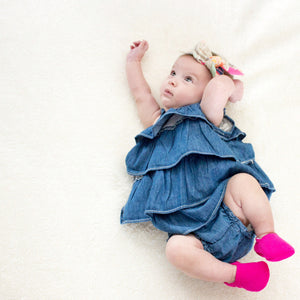 Baby girl wearing Electric Pink Loafie Brights baby shoes