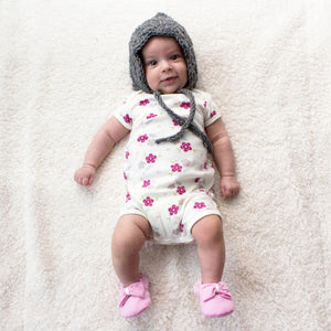 Baby girl wearing pink Big Bow Theory baby shoes