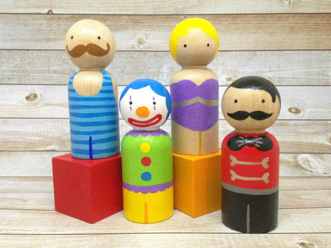 The Circus Set - Ringmaster, Trapeze Artist, Strongman, and Clown Peg Doll Set