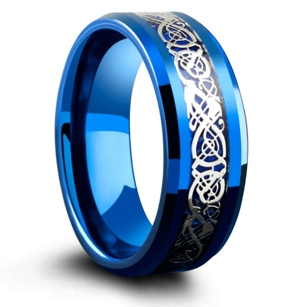 Blue 8mm Tungsten Carbide Ring With Silver Celtic Inlay Resting On