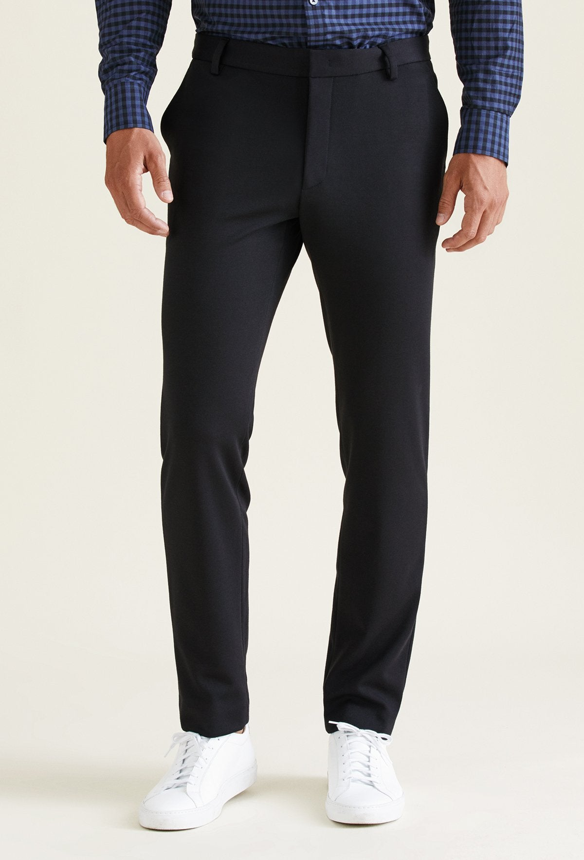 men's black knit dress pants featuring slant pockets and made with polyester