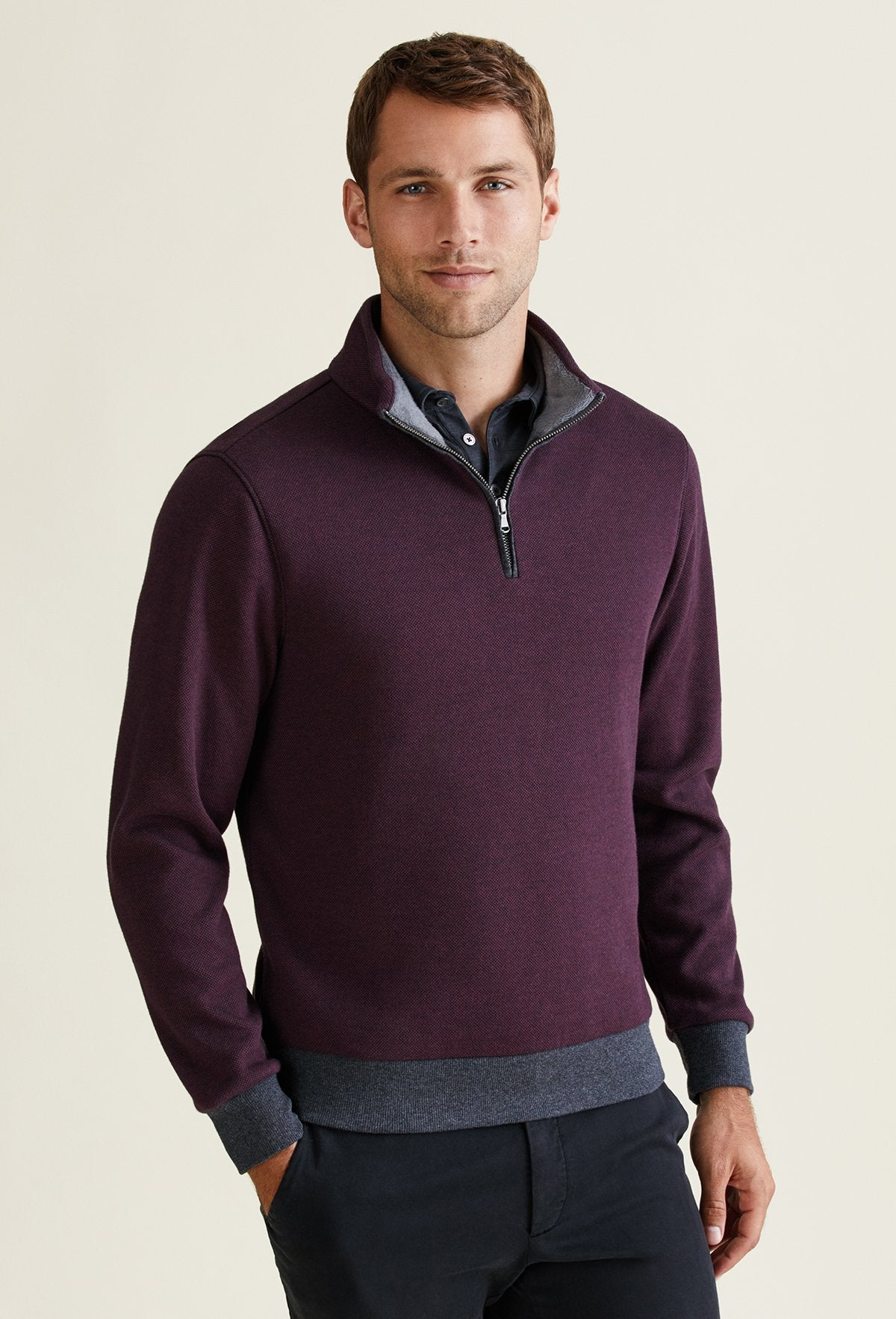 burgundy men's quarter zip sweater made from polyester, cotton and elastane