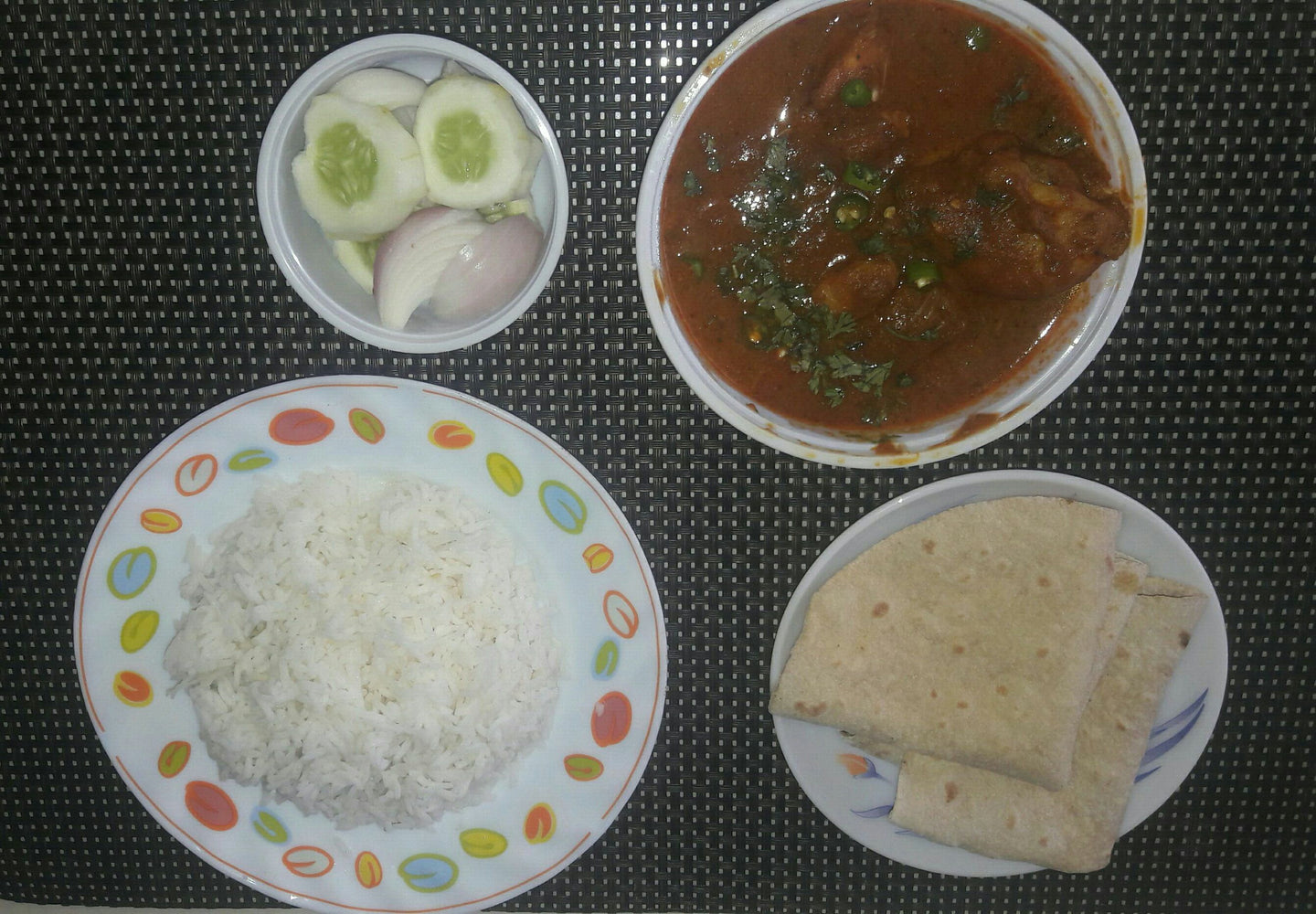 Coconut Chicken curry with Roti(2), Rice & Sliced Onion.
