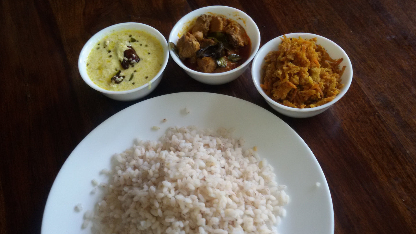 Boiled Red Rice with Spicy Fish Curry, Cucumber Pachadi & Carrot Thoran