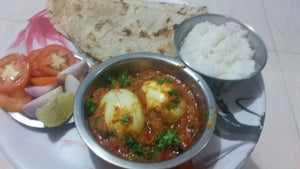 Egg curry, rotti or bhakri, steam rice,salad