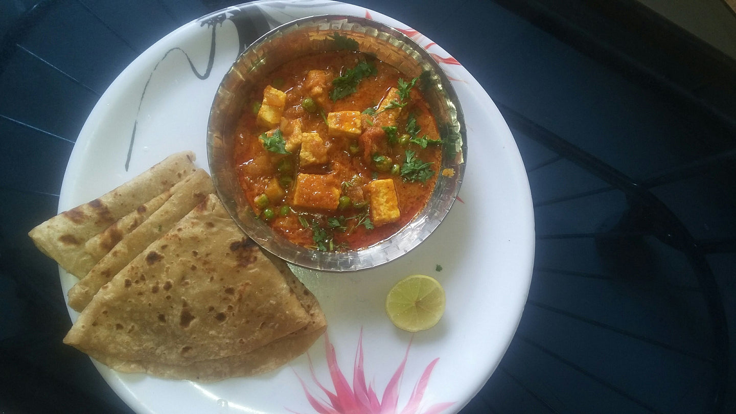 Mutter Paneer Masala, with Roti, Rice, Papad, & Pickle.