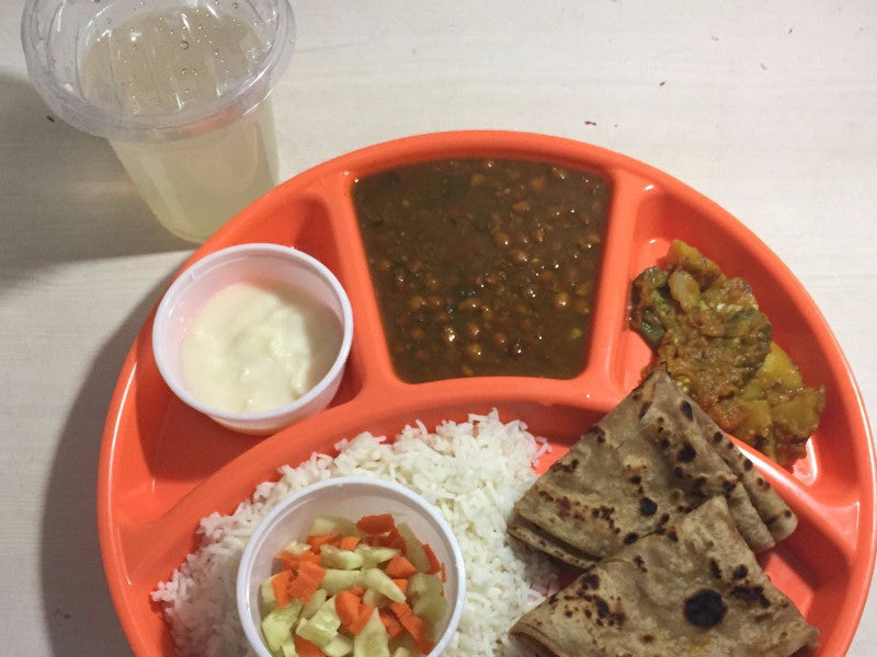 Black Chana Masala(gravy), Aloo Sabji, Rice, Roti(2), Salad, Sweet & Lemonade