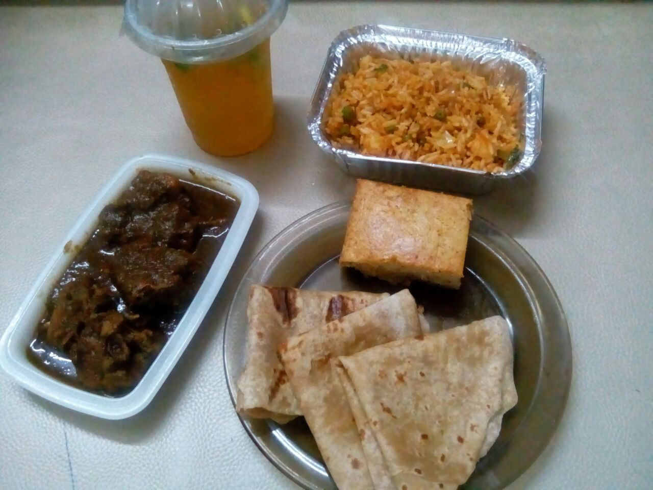 Black Chicken with Chapattis and Veg Fried rice and Banana Walnut Cake with Mint Iced tea