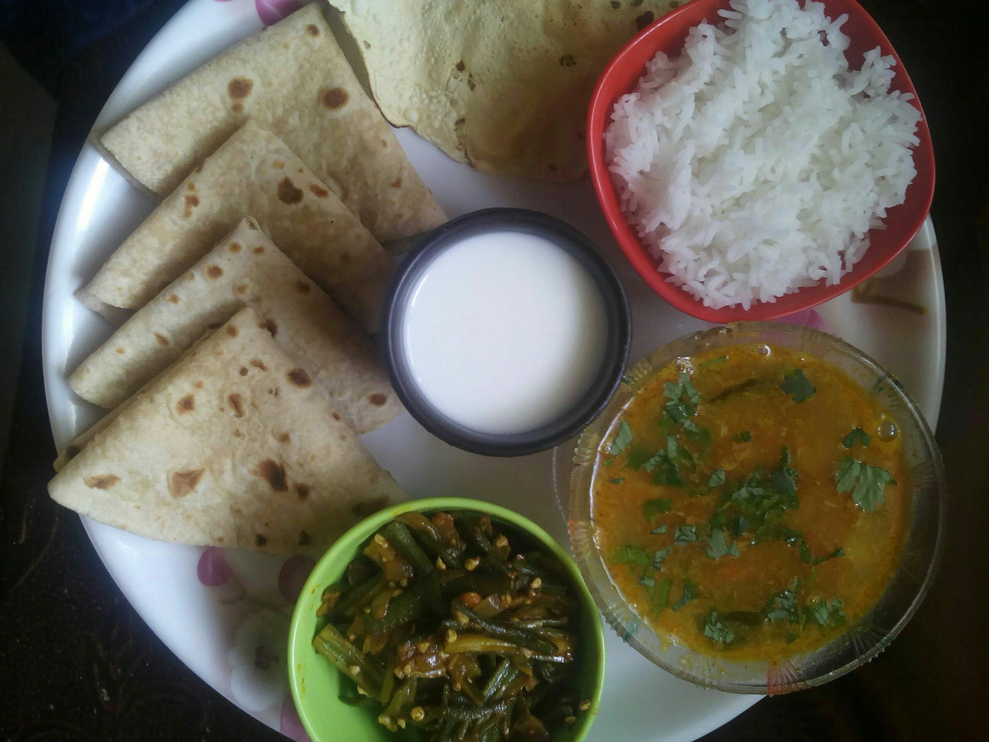 Bhindi ki sabji with chapati, Dal (Spicy), Rice, Salad & Papad