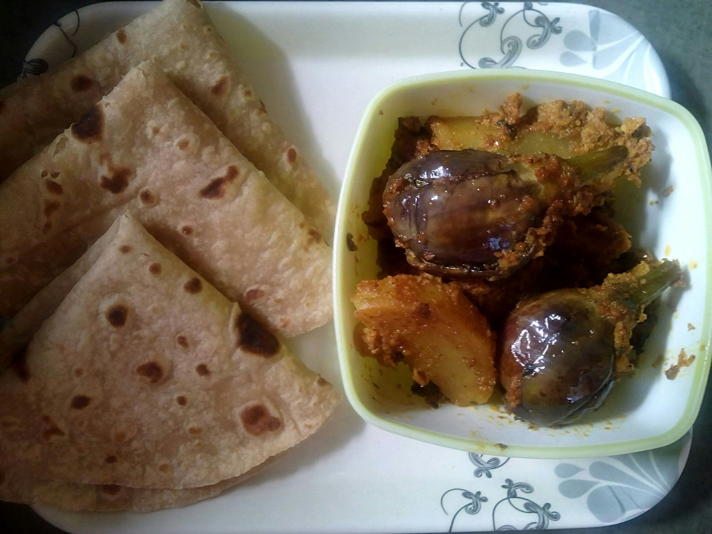 Stuffed Baingan Aloo Sabji with Chapati (5), Pickle, Papad & Buttermilk
