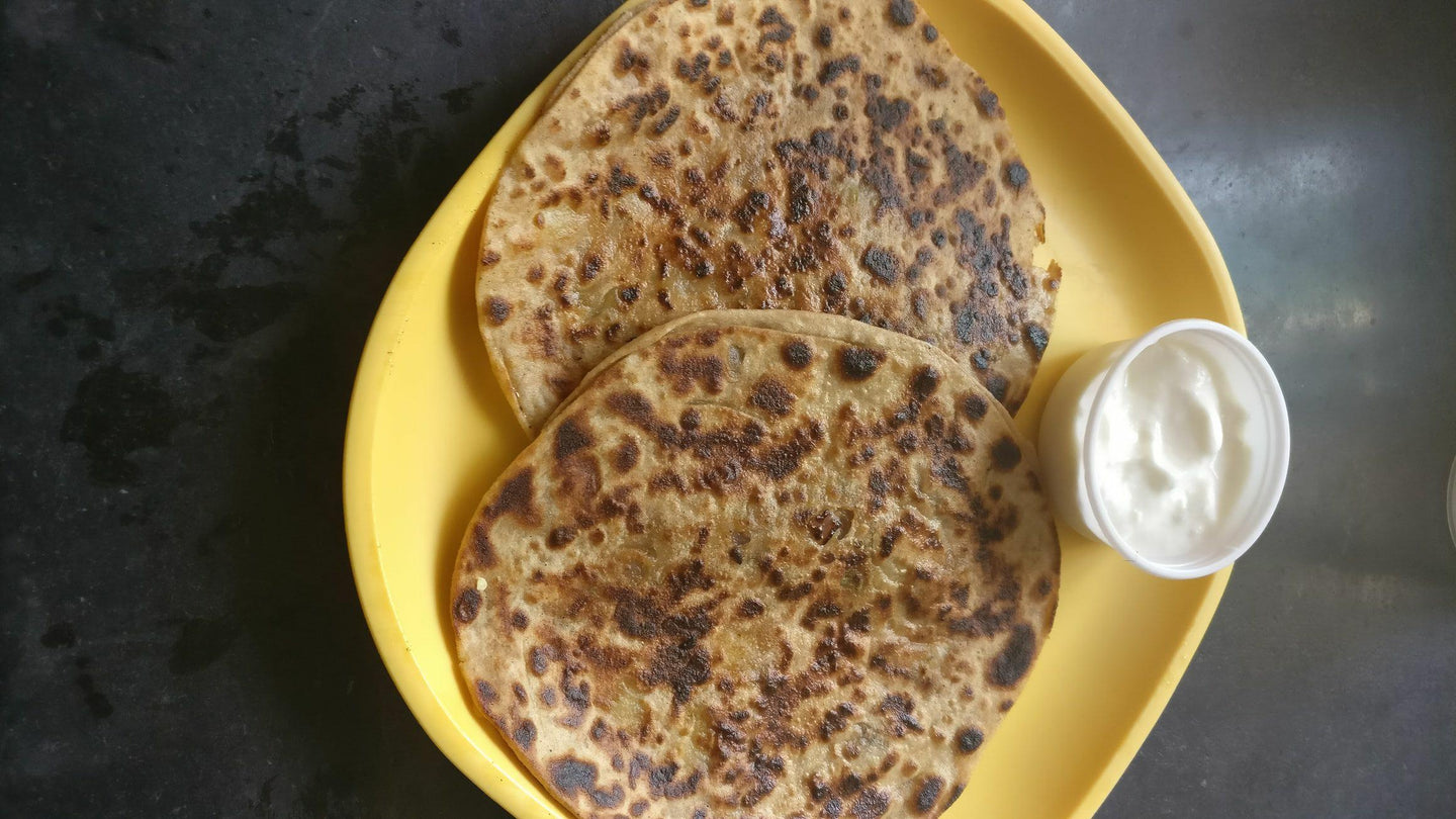 Paneer Paratha with Curd & Pickle.