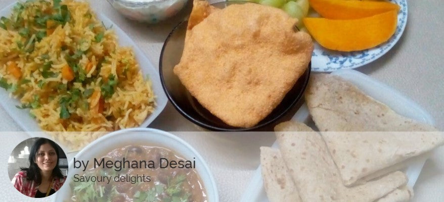 Rajma Curry, Chapatis (3), Tomato Rice, Poha Papad, Boondi Raita and Fruit Plate -  - Homely - By Meghana Desai