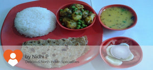 Aloo Matar Dry, Onion Paratha (3), Dal Tadka, Rice, Salad & Surprise Sweet -  - Homely - By Nidhi P.