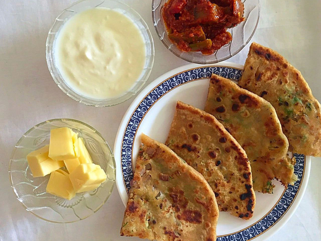 3 Assorted Stuffed Parathas (Aloo, Gobhi, Paneer), Curd, Butter, Pickle & Surprise Sweet -  - Homely - By Reeta Gupta