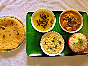 Paneer Butter Masala, Dal Tadka, Steamed Basmati Rice, Raita, Chapatis with Ghee/Butter and Dessert Surprise -  - Homely - By Prachi Mishra