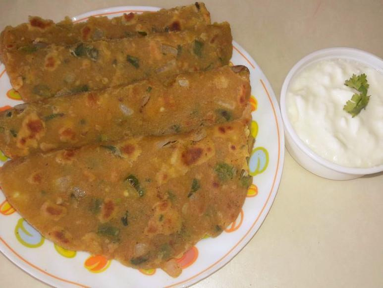 Onion Paratha(4) with Curd.